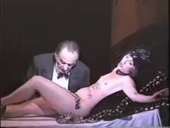 Soft core video with a hot chick on the stage