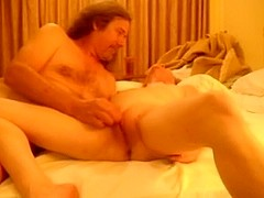 Fingering my mature wife on the bed