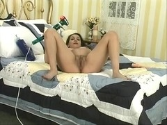 Brunette Hair playgirl fingers her taut cunt on a sofa