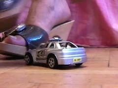 Minicar crushing by wooden slippers