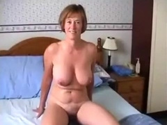 Busty mature blonde using a vibrator