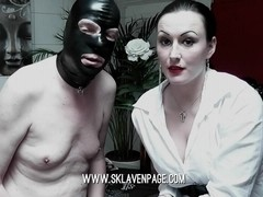 Neat domina mistress having fun with her serf