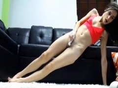 Skinny girl fucks her shaved pussy with dildo