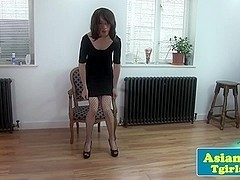 Solo tugging ladyboy in hot fishnet stockings