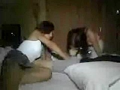 two teens sharing a cock