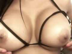 Amazing Latina with huge tits taking her bra off