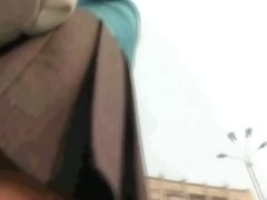 Alluring yellow panties are visible in the upskirt video
