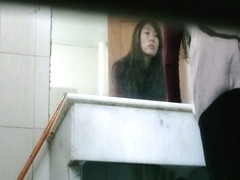 Hidden bathroom video of an Asian babe washing her hands after pissing