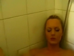 Lusty blonde gets naughty in the shower
