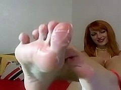 Cam Russian redhead lady, rubs lotion on her soles