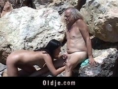 Kinky young brunette loves to suck flaccid old dick
