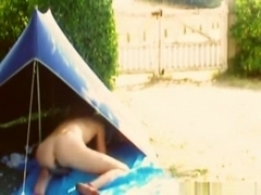 Brunette french canadian girl masturbates in a tent with a vibrator, while people pass by near the.