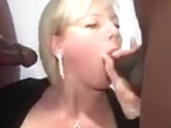 Mature blonde and a flock of black men