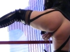 girl in fetish wear self bondage