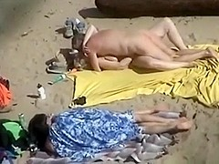 Voyeur tapes 2 nudist couples having at the beach