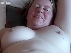 The wife playing with her cum-hole then showing her breasts during the time that i film her
