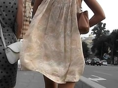 Gentle lady with wonderful legs walking down the street