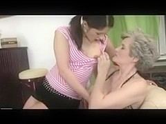 Busty mature and young girl licking pussy