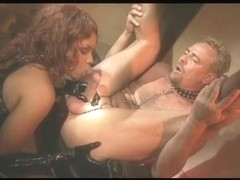 Darksome blowing a mature lad in a weird S&M outfit