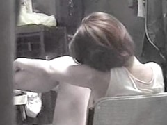 Sitting in the arm chair amateur masturbates before spy cam