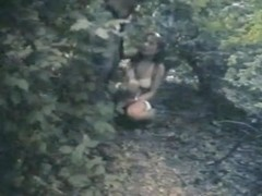 Couple hiding in the woods to take a piss on spy cam