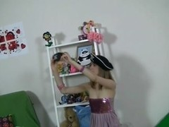 Cute angel plays with hot toys and bear