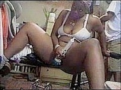 Large ebony chick toying