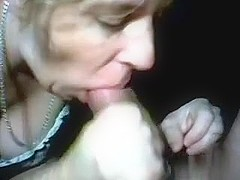 Amateur granny with blonde hair is sucking my wang and getting a facial, while wearing sexy stocki.