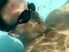 Couple enjoys oral sex under water