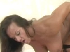 mature with massive body plays with a dildo