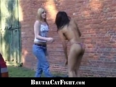 Two girls fight hard at a carwash