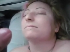 my wife getting a cum facial at the parking lot