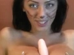 Nice brunette with big tits puts inside of her twat a dildo