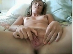 Small titted girl with tanlines masturbates her hairy pussy with a vibrator