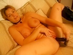 Mature woman using sex toys