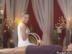 Blonde masseuse gently rubs pussy