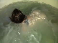 k playing in the hot tub