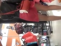 Woman in red skirt wearing stockings upskirted
