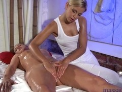 Blonde lesbian does a nice massage to her sexy mistress