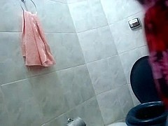 Hot Latina Strips in the Bathroom