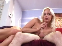 Blond acquires her hand around a thick dick and jerks it hard