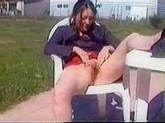 Teen showing bare pussy in garden