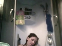 girl rubs one off in the shower and can't resist to moan