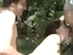 Outdoor threesome with spectators