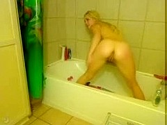 Blonde with Dildo in bath