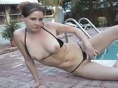 Girl in black thong bikini in swimming pool