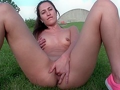 Cute little brunette fingering on a dyke in Holland
