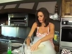 Sex in the kitchen with busty step-MILF