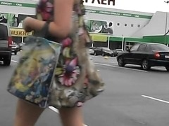 Horny voyeur films young lady in the sexy dress
