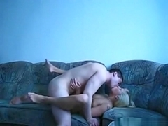 Hot blonde fucks in various positions on the sofa with belly cumshot